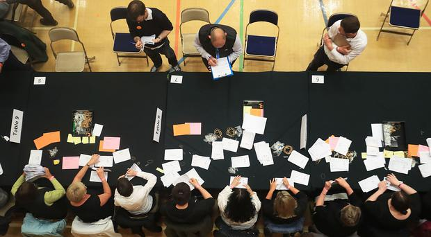 Election staff count ballot papers for the General Election, at Kendal Leisure Centre in Kendal (Danny Lawson/PA)