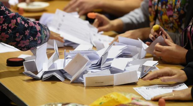 Election staff count ballot papers for the General Election, at the Peter Paine Performance Centre in Boston (Joe Giddens/PA)