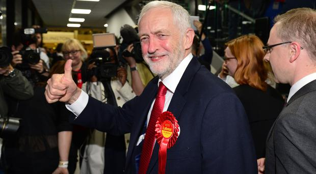 Jeremy Corbyn gives a thumbs-up as he arrives at the Sobell Leisure Centre in Islington (Dominic Lipinski/PA)