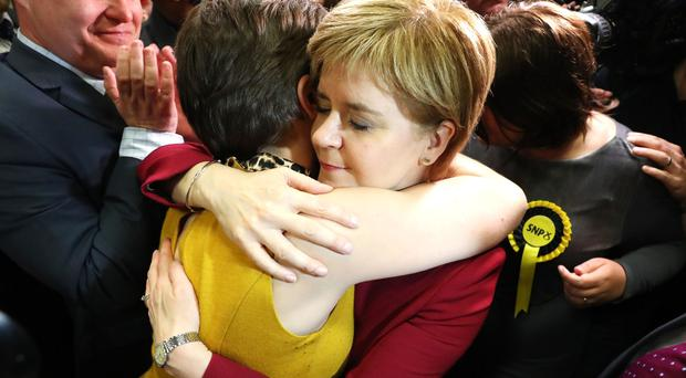 Nicola Sturgeon is hugged at the count in Glasgow (PA)