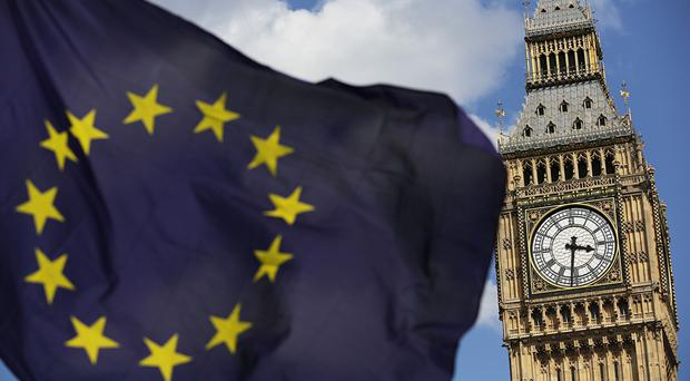 File photo dated 02/07/16 of a European Union flag in front of Big Ben. The prospect of a hung Parliament would throw serious doubt over Brexit negotiations, due to begin in earnest in just 10 days.