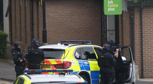 Police at the scene after a man armed with a knife held several members of staff at a Jobcentre Plus in Clifford Street in the Byker area of Newcastle (Scott Heppell/PA)