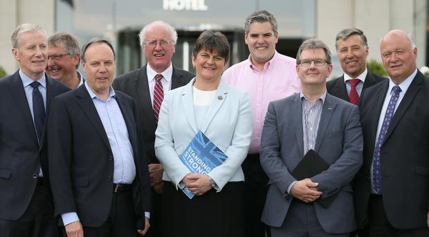 DUP leader Arlene Foster with MPs at the Stormont Hotel in Belfast. (Brian Lawless/PA)