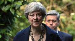 Theresa May is set to reshuffle her Cabinet (Jonathan Brady/PA)