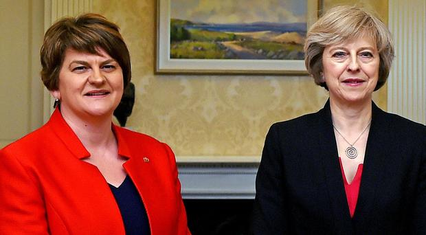 Arlene Foster (left), leader of the Democratic Unionist Party, with Prime Minister Theresa May (Charles McQuillan/PA)