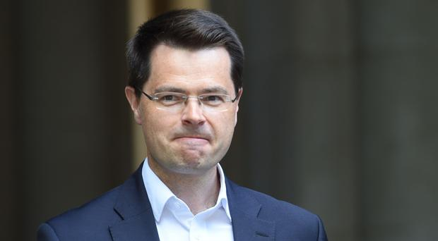 James Brokenshire said there was a need to differentiate between politics at Westminster and Stormont (David Mirzoeff/PA)