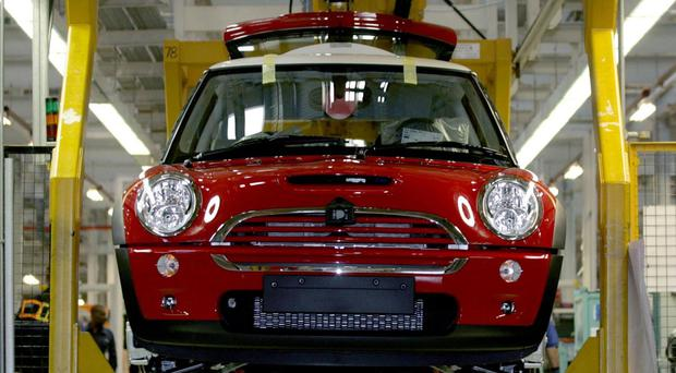 The production line for the Mini at the BMW plant in Cowley, Oxford (Anthony Devlin/PA)