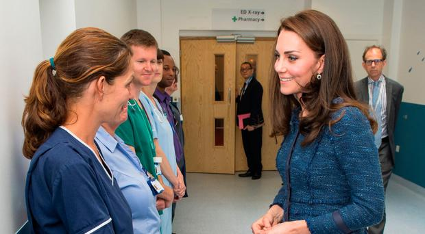 The Duchess of Cambridge speaking to medical staff during a visit to King's College Hospital in south London