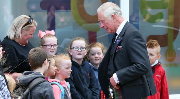 The Prince of Wales, known as the Duke of Rothesay while in Scotland, meets staff and pupils from Clarkhill Primary School during a visit to a Prince's Trust project to meet young people who have just completed The Prince's Trust Team Programme at the Aberdeen Foyer (Jane Barlow/PA)