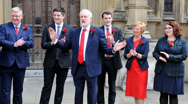Labour leader Jeremy Corbyn welcomes Scottish Labour MPs outside the Houses of Parliament (Nick Ansell/PA)