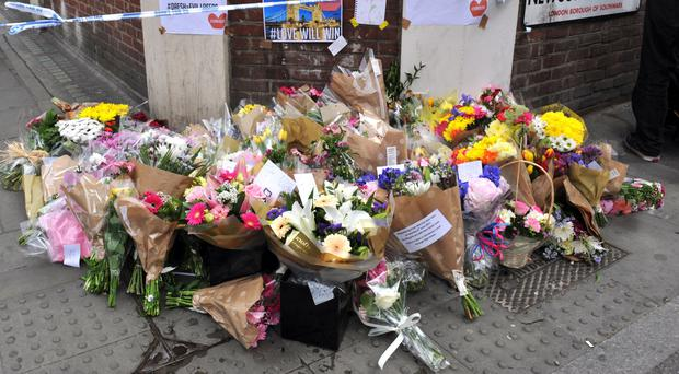 Floral tributes and messages left near Borough Market (Nick Ansell/PA)