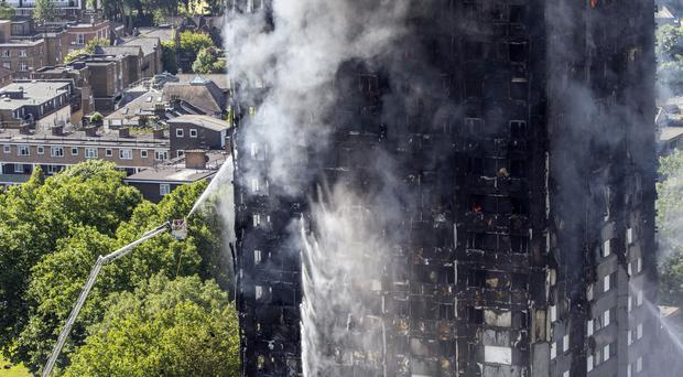 Smoke billows from a fire that has engulfed the 24-storey Grenfell Tower in west London (Rick Findler/PA)
