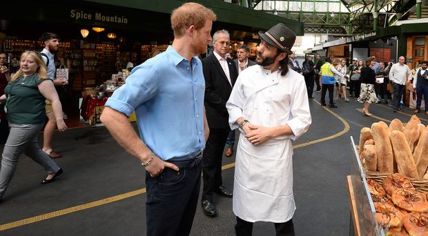 Prince Harry meets with traders. (John Stillwell/PA)