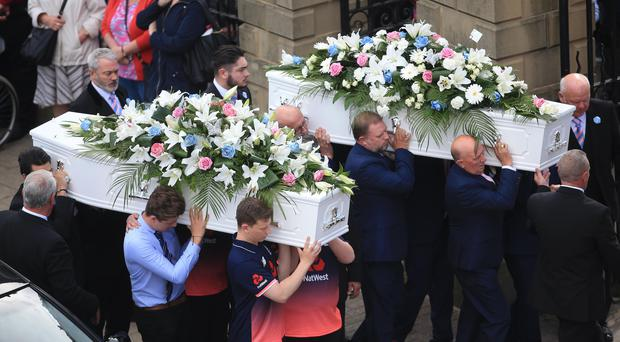 The two coffins are carried into church. (Danny Lawson/PA)