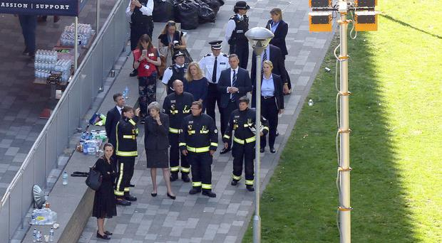 Theresa May visits the scene of the fire (Rick Findler/PA)