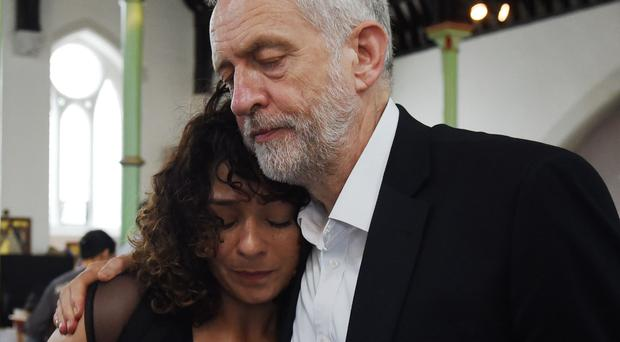 Jeremy Corbyn comforts a local resident affected by the fire at Grenfell Tower (David Mirzoeff/PA)