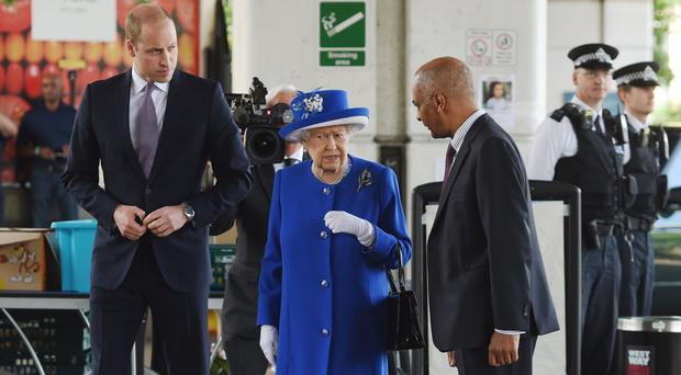 Queen Elizabeth II and the Duke of Cambridge arrive to meet members of the community affected by the fire at Grenfell Tower (David Mirzoeff/PA)