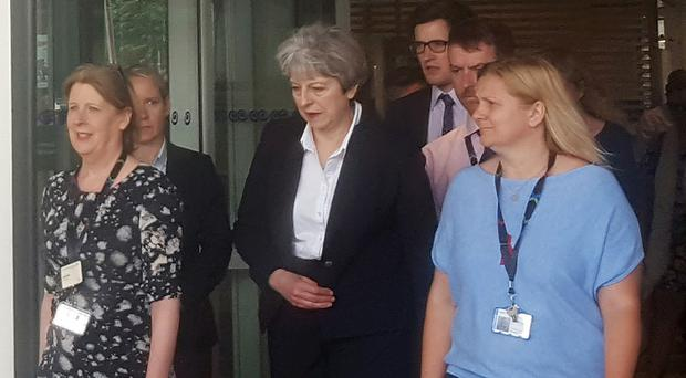 Prime Minister Theresa May leaves the Chelsea and Westminster Hospital in London after visiting people who were injured in the Grenfell Tower fire (Helen William/PA)