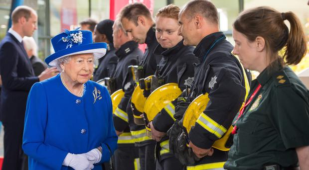 The Queen meeting emergency workers. (Dominic Lipinski/PA)