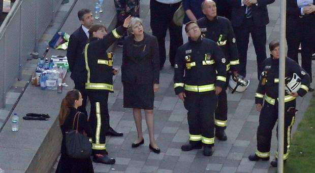 Mrs May at the scene earlier in the week. (Rick Findler/PA)