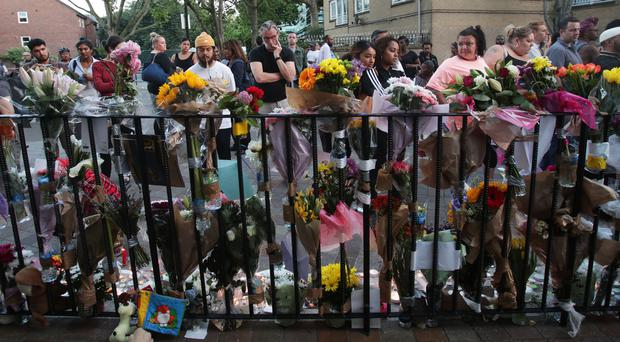 Floral tributes left near Grenfell Tower (Yui Mok/PA)