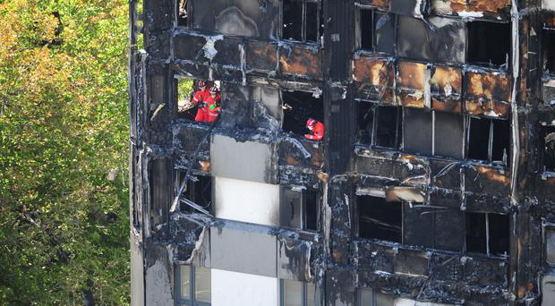 Urban search and rescue officers from London Fire Brigade inside Grenfell Tower (David Mirzoeff/PA)