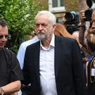 Jeremy Corbyn met staff and volunteers at a church near the scene (David Mirzoeff/PA)