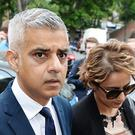Sadiq Khan and his wife arrive at the church. (John Stillwell/PA)