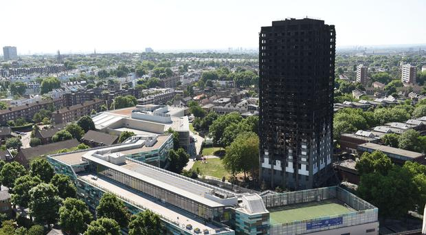 Grenfell Tower in west London after a fire engulfed the 24-storey building on Wednesday morning. [Photo: David Mirzoeff/PA Wire]