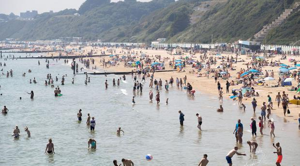 People spent more time outside in the hot weather (Steve Parsons/PA)