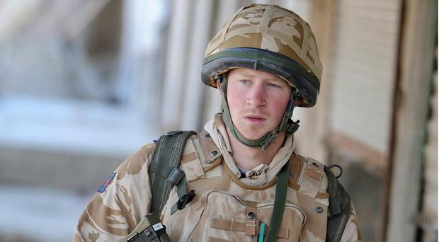 Prince Harry says that Afghanistan prompted him to deal with problems brought about by his mother's death (John Stillwell/PA)