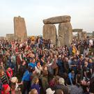Approximately 13,000 people descended on Stonehenge to watch the sun rise (Steve Parsons/PA)