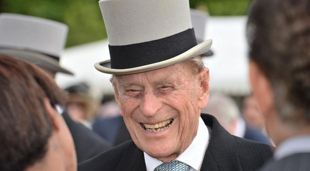 The Duke of Edinburgh speaking to guests at a garden party at Buckingham Palace (John Stillwell/PA Wire/PA Images)