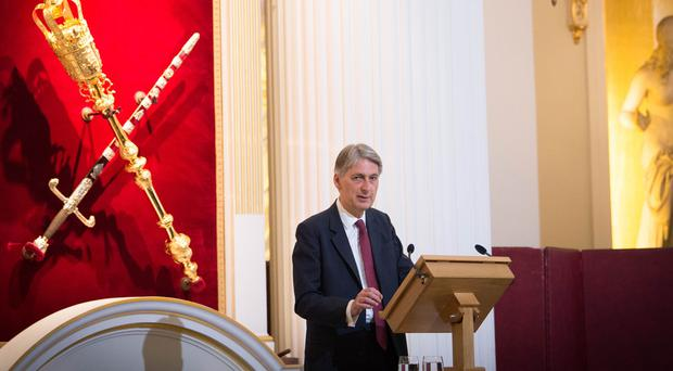 Philip Hammond has admitted post-Brexit transitional arrangements may be needed for years (Stefan Rousseau/PA)