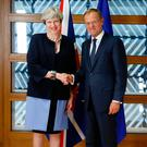 Prime Minister Theresa May and European Council President Donald Tusk during a EU leaders summit in Brussels yesterday