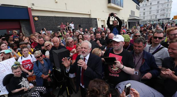 Labour leader Jeremy Corbyn addresses crowds outside the conference (Gareth Fuller/PA)