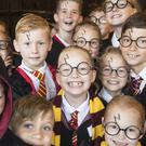 Children dressed as Harry Potter at Smithills Hall in Bolton, as they attempt to break the Guinness World Record for the Largest Gathering of People Dressed as the boy wizard (Danny Lawson/PA)