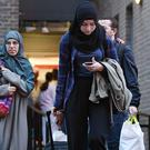 Residents leave the Taplow tower block on the Chalcots Estate in Camden (Stefan Rousseau/PA)