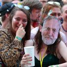 A festivalgoer wearing a Jeremy Corbyn mask at Glastonbury (Yui Mok/PA)