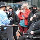 Anti-fascist activists gather near the Library of Birmingham to protest against the presence of Britain First supporters in the city's Centenary Square (Matthew Cooper/PA)