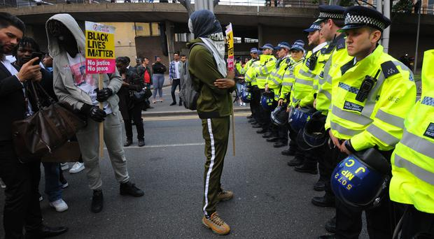 Campaigners face off with police as they protest over the death of Edir Frederico Da Costa (Lauren Hurley/PA)