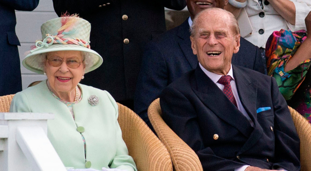 The Queen and the Duke of Edinburgh watch a British Driving Society parade at Guards Polo Club, Windsor Great Park