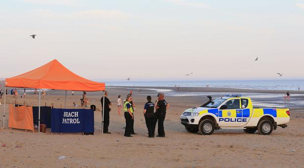 Police officers on Camber Sands near Rye, East Sussex after five young men died in August (Gareth Fuller/PA)