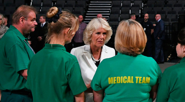 The Duchess of Cornwall and Prince Charles meet medical and security staff at the Manchester Arena who helped victims of the May 22 bomb attack