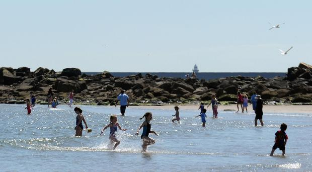 A poll found evidence of apparently relaxed attitudes to children and sun exposure (Myung Jung Kim/PA)