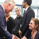 The Prince of Wales meets volunteers at the Westway Centre (Philip Toscano/PA)