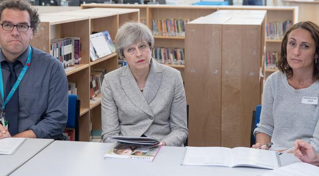 Theresa May sits in on a teacher training session at Orchard School in Bristol (Matt Cardy/PA)