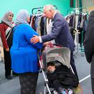 The Prince of Wales meets local residents during a visit to the Westway Sports Centre, which is acting as a relief centre for those who have been affected by the Grenfell Tower disaster