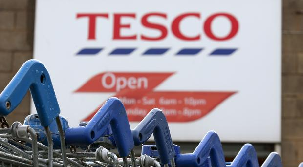 Tesco is in the midst of a turnaround plan under chief executive Dave Lewis (Andrew Milligan/PA)