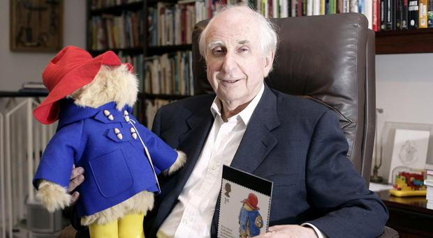 Michael Bond, who has died agwed 91, with his most famous creation - Paddington Bear (Edmond Terakopian/PA)
